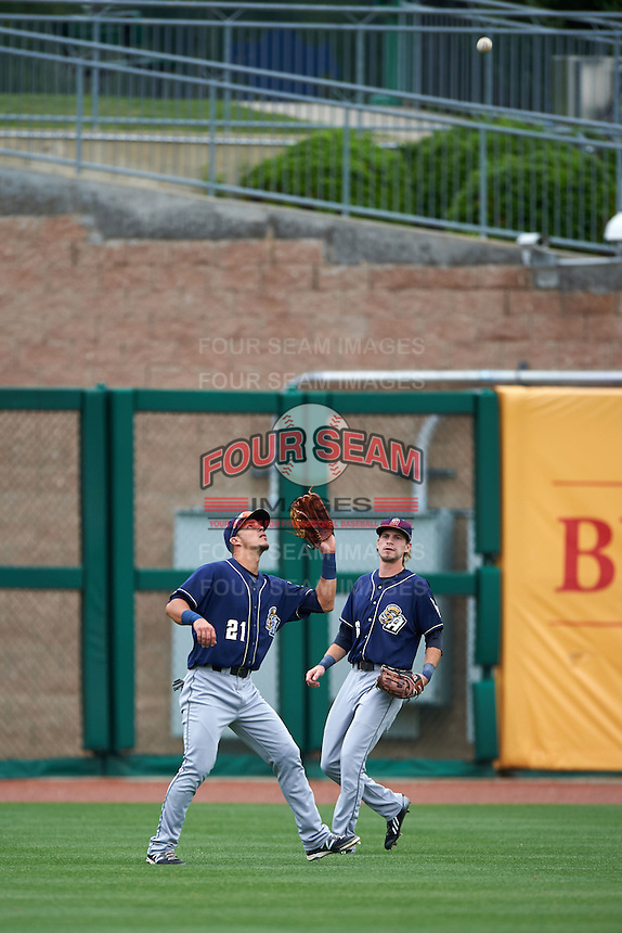 San Antonio Missions outfielder Alberth Martinez (21) catches a fly ball as Travis Jankowski (6) looks on during a game against the NW Arkansas Naturals on May 31, 2015 at Arvest Ballpark in Springdale, Arkansas.  NW Arkansas defeated San Antonio 3-1.  (Mike Janes/Four Seam Images)