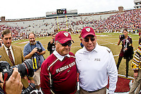 November 21, 2009:   Florida State head coach Bobby Bowden (L) poses for a photo with defensive coordinator Mickey Andrews who is retiring after 26 seasons with the  Seminoles prior to the start of action Atlantic Coast Conference action between the Maryland Terrapins and Florida State Seminoles at Doak Campbell Stadium in Tallahassee, Florida.  Florida State defeated Maryland 29-26.