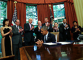 """United States President Barack Obama signs S 1890, the """"Defend Trade Secrets Act of 2016,"""" which amends the Economic Espionage Act to allow private parties to seek civil remedies in Federal court for trade secret misappropriation, in the Oval Office of the White House, May 11, 2016, Washington, DC.  Present during the signing behind the President from left to right: (Deputy) Under Secretary Michelle Lee, Department of Commerce; US Representative Bob Goodlatte (Republican of Virginia); US Senator Orrin Hatch (Republican of Utah); US Senator Chris Coons (Democrat of Delaware); US Representative Doug Collins (Republican of Georgia); US Representative Jerrold Nadler (Democrat of New York); US Representative Hakeem Jeffries (Democrat of New York); US Attorney General Loretta Lynch.<br /> Credit: Aude Guerrucci / Pool via CNP"""