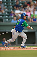 Third baseman Carlos Diaz (14) of the Lexington Legends follows through on a swing during a game against the Greenville Drive on Saturday, September 1, 2018, at Fluor Field at the West End in Greenville, South Carolina. Greenville won, 9-6. (Tom Priddy/Four Seam Images)