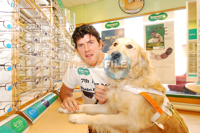 "Irish International Rugby Player Shane Horgan with Guide Dog Bruce helping to launch the Irish Guide Dogs for the Blind ""Shades for a Day"" on May 7th in Specsavers in Drogheda town Centre..Photo AFP/NEWSFILE/FRAN CAFFREY..(Photo credit should read FRAN CAFFREY/NEWSFILE/AFP)...This Picture has been sent you under the condtions enclosed by:.Newsfile Ltd..the Studio,.Millmount Abbey,.Drogheda,.Co Meath..Ireland..Tel: +353(0)41-9871240.Fax: +353(0)41-9871260.GSM: +353(0)86-2500958.email: pictures@newsfile.ie.www.newsfile.ie.FTP: 193.120.102.198..This picture is from Fran Caffrey@newsfile.ie"