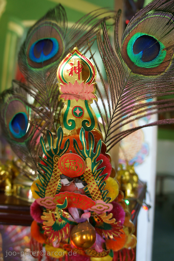 decoration of a private chinese shrine in a restaurant in Phnom Penh, Cambodia, August 2011