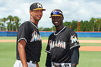 GCL Marlins Aneury Osoria (10) and Javier Lopez (7) before the second game of a doubleheader against the GCL Mets on July 24, 2015 at the St. Lucie Sports Complex in St. Lucie, Florida.  GCL Marlins defeated the GCL Mets 5-4.  (Mike Janes/Four Seam Images)