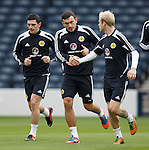 Steven Naismith congratulates Robert Snodgrass at Hampden with Graham Dorrans alongside