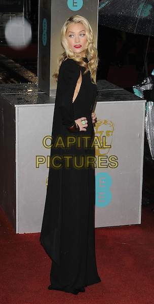 Laura Whitmore.EE British Academy Film Awards at The Royal Opera House, London, England 10th February 2013.BAFTA BAFTAS arrivals full length black jumpsuit long sleeves gold cuffs bracelets hand on hip cape side .CAP/CAN.©Can Nguyen/Capital Pictures.