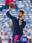 12 October 2014: New England Patriots quarterback Jimmy Garoppolo warms up prior to facing the Buffalo Bills at Ralph Wilson Stadium in Orchard Park, NY. The Patriots defeated the Bills 37-22 to move into first place in the AFC Eastern Division. Mandatory Credit: Ed Wolfstein Photo *** RAW (NEF) Image File Available ***