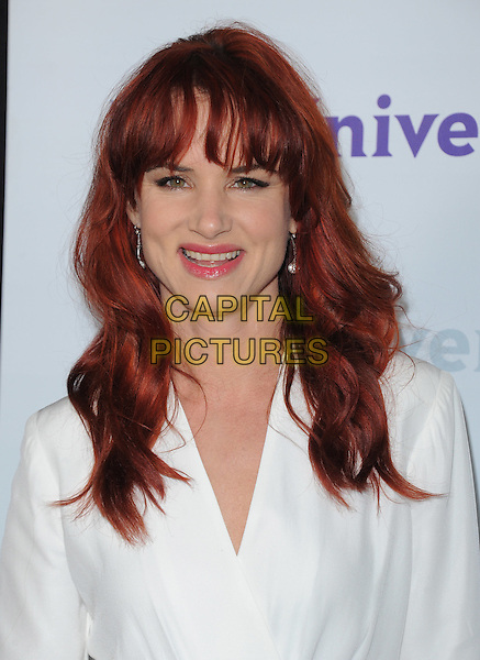 Juliette Lewis .at The NBC Universal Press Tour All-Star Party, The Athenaeum, Pasadena, California, USA, January 6th 2012..portrait headshot  fringe dyed red hair  white                          .CAP/RKE/DVS.©DVS/RockinExposures/Capital Pictures.