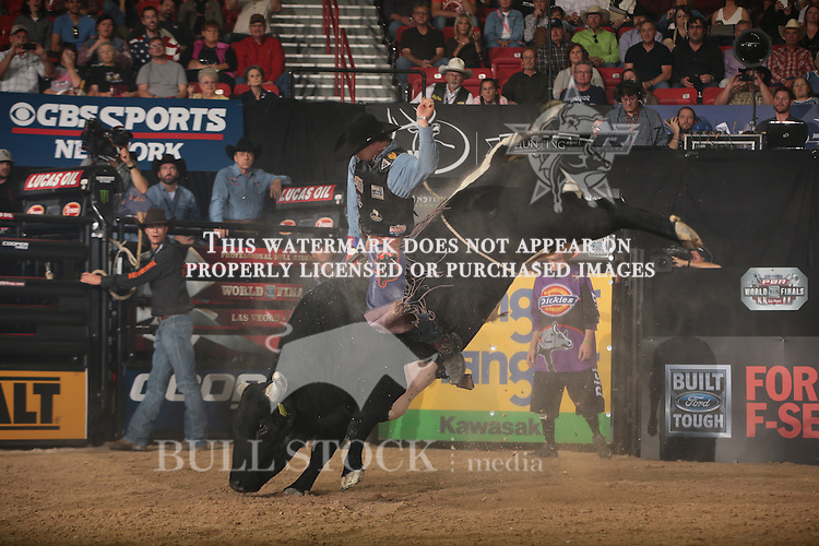 Mason Lowe rides 3CM Cattle Co.'s Gangster Bucks for 85.5 during the first round of the World Finals Built Ford Tough Series PBR. Photo by Andy Watson