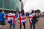 Uruguay 2 United Arab Emirates 1, Great Britain 1 Senegal 1, 26/07/2012. Old Trafford, Olympic Games. Three supporters of the Great Britain football team walking towards Manchester United's Old Trafford stadium prior to the Men's Olympic Football tournament matches at the venue. The double header of matches resulted in Uruguay defeating the United Arab Emirates by 2-1 while Great Britain and Senegal drew 1-1. Over 72,000 spectators attended the two Group A matches. Photo by Colin McPherson.