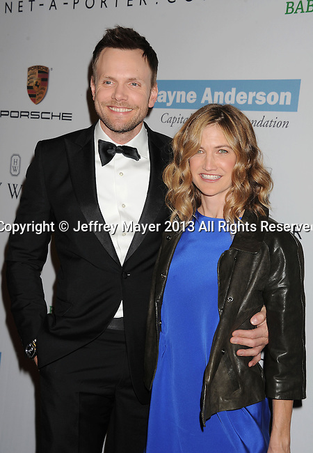 CULVER CITY, CA- NOVEMBER 09: Host/actor Joel McHale (L) and wife Sarah Williams arrive at the 2nd Annual Baby2Baby Gala at The Book Bindery on November 9, 2013 in Culver City, California.