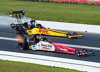 Apr 14, 2019; Baytown, TX, USA; NHRA top fuel driver Clay Millican (near) races alongside Richie Crampton during the Springnationals at Houston Raceway Park. Mandatory Credit: Mark J. Rebilas-USA TODAY Sports