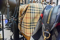 Burberry designer bags on sale at the Saks Fifth Avenue Off Fifth discount spin-off brand in New York, seen on Sunday, March 6, 2016. The 47,000 square foot store, selling discounted merchandise also contains a Gilt Groupe shop which will offer weekly flash sales. Hudson's Bay Co., the owner of Saks, recently purchased the Gilt Groupe.  (© Richard B. Levine)
