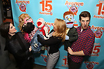 """Veronica J. Kuehn and Matt Dengler with Avenue Q & Puppetry Fans during """"Avenue Q"""" Celebrates World Puppetry Day at The New World Stages on 3/21/2019 in New York City."""