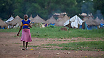 A girl walks to school in a camp for internally displaced persons that formed around the Our Lady of Assumption Catholic Church in Riimenze, South Sudan. The parish has provided food, shelter material, and health care, and the presence of the local priest and a group of religious has contributed to a sense of relative safety.