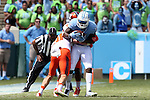 19 September 2015: UNC's Quinshad Davis (14) is tackled by Illinois' Clayton Fejedelem (20) and Darius Mosely (14). The University of North Carolina Tar Heels hosted the University of Illinois Fighting Illini at Kenan Memorial Stadium in Chapel Hill, North Carolina in a 2015 NCAA Division I College Football game. UNC won the game 48-14.