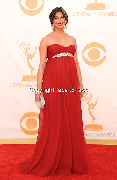 Morena Baccarin arrives at the 65th Primetime Emmy Awards at Nokia Theatre on Sunday Sept. 22, 2013, in Los Angeles.<br />