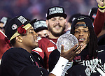 FSU freshman Heisman quarterback Jameis Winston (L) and wide receiver Kelvin Benjamin look at the crystal football after winning the national championship on Winston's birthday and the offensive MVP at the BCS national title game at the Rose Bowl in Pasadena, California on January 6, 2014.  Florida State Seminoles defeated the Auburn Tigers 34-31 for the title.