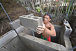 Imarito Macalalad constructs a septic tank in Bacubac, a seaside neighborhood in Basey in the Philippines province of Samar that was hit hard by Typhoon Haiyan in November 2013. The storm was known locally as Yolanda. Norwegian Church Aid, a member of the ACT Alliance, is sponsoring the construction of bathrooms with septic systems for houses in the village where existing systems were destroyed by the typhoon's unusually high storm surge.
