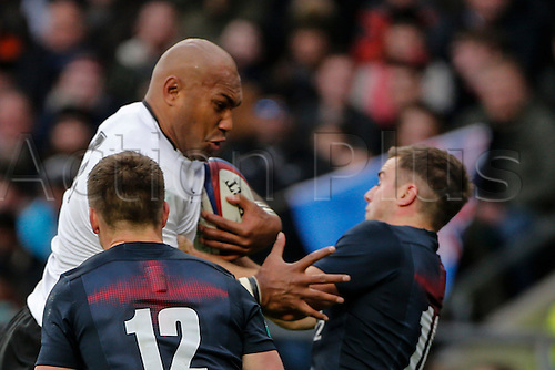 19.11.2016. Twickenham, London, England. Autumn International Rugby. England versus Fiji.  Nemani Nadolo of Fiji is tackled by Owen Farrell and George Ford of England.   Final score: England 58-15 Fiji.