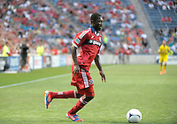 Chicago midfielder Patrick Nyarko (14) dribbles toward the Columbus goal.  The Chicago Fire defeated the Columbus Crew 2-1 at Toyota Park in Bridgeview, IL on June 23, 2012.