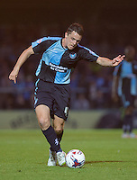 Stephen McGinn of Wycombe Wanderers prepares to shoot at goal during the Capital One Cup match between Wycombe Wanderers and Fulham at Adams Park, High Wycombe, England on 11 August 2015. Photo by Andy Rowland.