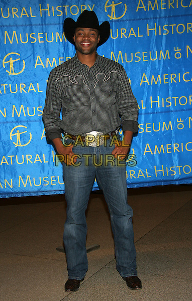 COWBOY TROY.American Museum of Natural History Annual Gala Benefit, New York, NY..November 16th, 2005.Photo: Jackson Lee/Admedia/Capital Pictures.Ref: JL/ADM.full length jeans denim cowboy hat stetson grey gray shirt buckle.www.capitalpictures.com.sales@capitalpictures.com.© Capital Pictures.