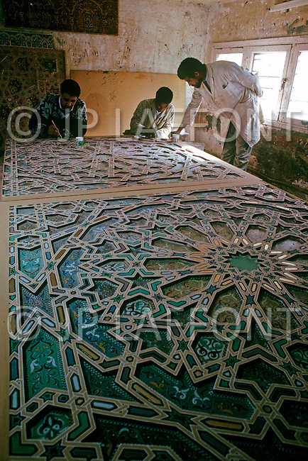 March 9, 1989, Casablanca, Morocco. Artcraft masters and artists working on the art labor for the construction of Hassan II Mosque. The mosque was completed in 1993.