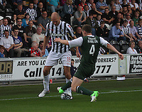 Sam Parkin tackled by Paul Hanlon in the St Mirren v Hibernian Clydesdale Bank Scottish Premier League match played at St Mirren Park, Paisley on 18.8.12.