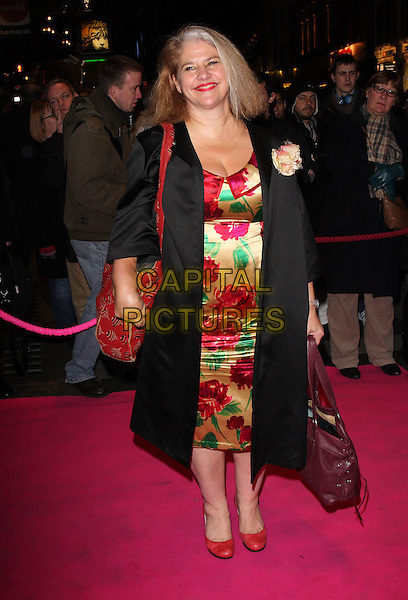 DENISE BLACK.Press night for 'My Trip DownThe Pink Carpet' at the Apollo Theatre, Shaftesbury Avenue, London, England..February 3rd 2011.full length black silk satin coat red gold green floral print dress bag purse shoes purple.CAP/ROS.©Steve Ross/Capital Pictures