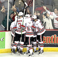UNO celebrates Rich Purslow's empty-net goal during the third period. Nebraska-Omaha beat Denver 5-2 Friday night at Qwest Center Omaha.  (Photo by Michelle Bishop)