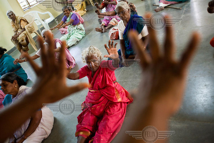 A daily exercise class for residents at the Tamaraikulum Elders's Village. The village is a pioneering experiment initially set up by HelpAge India after the Asian Tsunami to help elderly people displaced by the natural disaster. Today, the village is a self-sustaining community providing a family environment where more able-bodied residents assist the less able-bodied and provides 100 older people with a safe place to live, free healthcare, emotional security, a good diet and professional care and support...