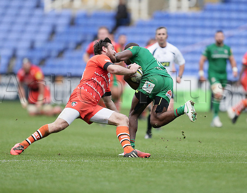 01.11.2014.  Reading, England.  LV Cup Rugby. London Irish versus Leicester Tigers. Topsy Ojo is stopped by Tommy Bell.
