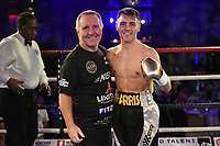 Jay Harris (R) with father Peter Harris after defeating Gyula Dodu during a Charity Dinner Boxing Show at the Hilton Hotel on 13th November 2017