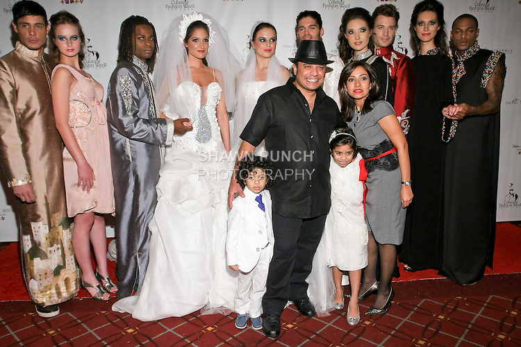 Fashion designer Siraj Sanad poses with family, friends and models after the Siraj Sanad Spring 2011 runway show, during Couture Fashion Week, September 12, 2010.
