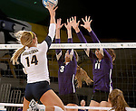 SIOUX FALLS, SD - OCTOBER 14: Bailey Koch #14 from Augustana tips the ball past Jordan Calef #3 and Kate Hart #11 from the University of Sioux Falls in the first game of their match Tuesday night at the Elmen Center. (Photo by Dave Eggen/Inertia)