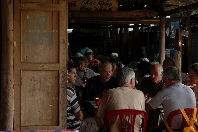 Tourists eat lunch at a Vietnamese restaurant in Can Tho, Vietnam.