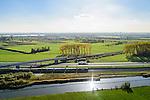 Nederland, Gelderland, Betuwe, 24-10-2013; Betuweroute, ter hoogte van Echteld. De goederenspoorlijn loopt parallel aan autosnelweg A15. De goederentrein is onderweg naar de haven van Rotterdam. Het spoor voor de gewone trein kruist de Betuwelijn, de A15 en de rivier de Linge.<br /> Betuweroute, railway from Rotterdam to Germany, near Echteld. The freight railway runs parallel to highway A15. The freight is on its way to the port of Rotterdam.<br /> luchtfoto (toeslag op standaard tarieven);<br /> aerial photo (additional fee required);<br /> copyright foto/photo Siebe Swart.