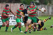 Kiwa Wilson makes a flying tackle around the leg of Kato Nganeko. Counties Manukau Premier Club Rugby game between Waiuku and Bombay, played at Waiuku on Saturday July 5th 2010. Waiuku won 59 - 14 after trailing 12 - 14 at halftme.