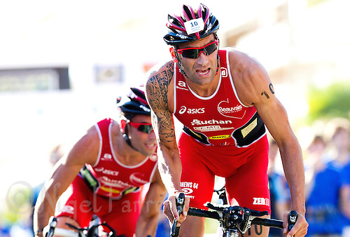 18 SEP 2010 - LA BAULE, FRA - Stephane Poulet leads Beauvais Tri team mate Sylvain Sudrie at the start of another lap during the 2010 Mens French Club Championship Final (PHOTO (C) NIGEL FARROW)