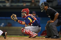 State College Spikes catcher Jose Godoy (35) and umpire Jose Matamoros during a game against the Batavia Muckdogs August 23, 2015 at Dwyer Stadium in Batavia, New York.  State College defeated Batavia 5-3.  (Mike Janes/Four Seam Images)