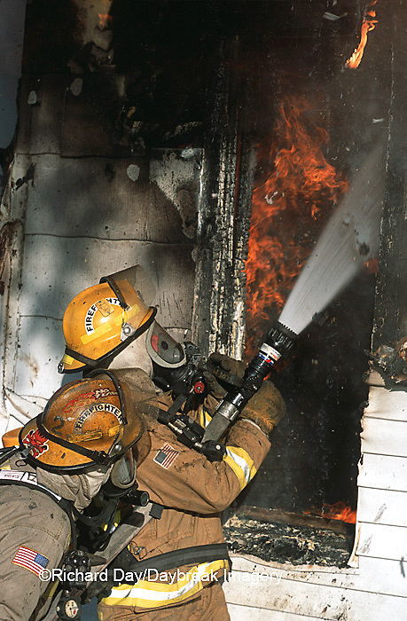 63818-01410 Firefighters extinguishing house fire  Kinmundy-Alma Fire District,  Kinmundy IL