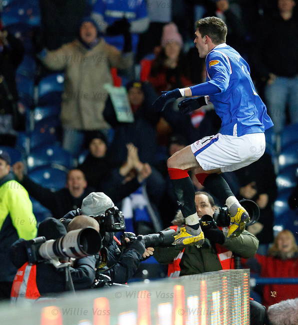Kyle Lafferty vaults the hoardings as he celebrates his winning goal