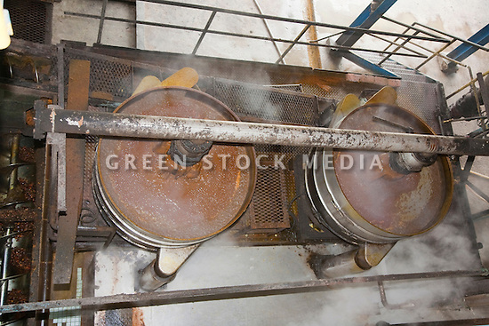Looking down at steaming tubs of palm oil crude at the mill. The Sindora Palm Oil Mill, owned by Kulim, is green certified by the Roundtable on Sustainable Palm Oil (RSPO) for its environmental, economic, and socially sustainable practices. Johor Bahru, Malaysia