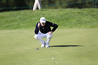 Tyrrell Hatton (ENG) lines up his putt on the 17th green during Thursday's Round 1 of the 2017 Omega European Masters held at Golf Club Crans-Sur-Sierre, Crans Montana, Switzerland. 7th September 2017.<br /> Picture: Eoin Clarke | Golffile<br /> <br /> <br /> All photos usage must carry mandatory copyright credit (&copy; Golffile | Eoin Clarke)