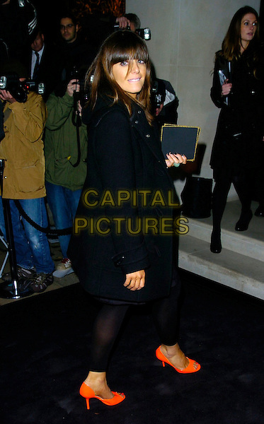CLAUDIA WINKLEMAN.The Donna Karan Gold Fragrance Collection Launch, Donna Karan, New Bond Street, London, UK..November 16th, 2006.Ref: CAN.full length black coat orange shoes leggings.www.capitalpictures.com.sales@capitalpictures.com.©Can Nguyen/Capital Pictures