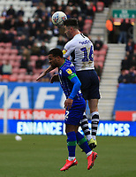 8th February 2020; DW Stadium, Wigan, Greater Manchester, Lancashire, England; English Championship Football, Wigan Athletic versus Preston North End; Andrew Hughes of Preston North End wins the ball in the air from Nathan Byrne of Wigan Athletic