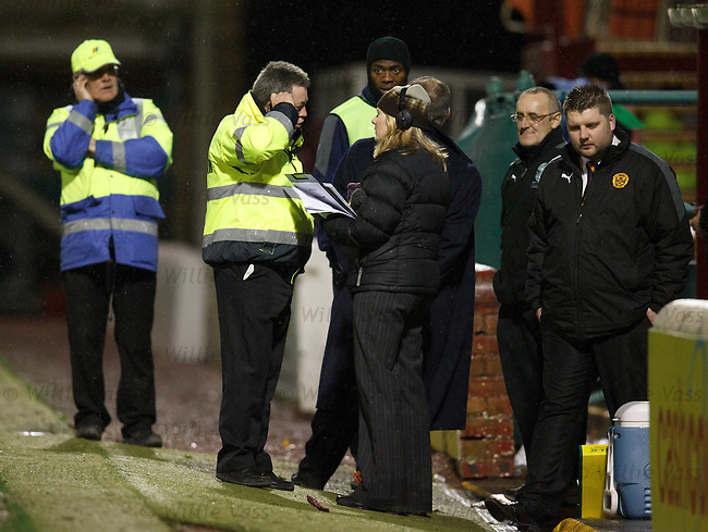 Motherwell safety officers hold a briefing at the tunnell just before the game is abandoned