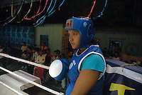 INDIA (West Bengal - Calcutta)August 2007, Shanno Babe inside the ring during a championship  in Kolkata. Shakila and Shanno are twins from a poor muslim family of Iqbalpur, Kolkata. . Inspite of their late father's unwillingness to send his daughters to take up  boxing her mother Banno Begum inspired them to take up boxing at the age of 3. Their father was more concerned about the social stigma they have in their community regarding women coming into sports or doing anything which may show disrespect to the religious emotions of his community. Shakila now has been recognised as one of the best young woman boxers of the country after she won the  international championship at Turkey in the junior category. Shanno is also been called for the National camp this year. Presently Shakila and shanno has become the role model in the Iqbalpur area  and parents from muslim community of Iqbalpur have started showing interst in boxing. Iqbalpur is a poor muslim dominated area mostly covered with shanty town with all odds which comes along with poverty and lack of education. - Arindam Mukherjee
