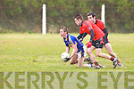 Cordal's Padraig Dignan gets his pass away against Gleneigh/Glencar's Sean Roche and Ger Hoare in the dvision 3 game at Cordal on Sunday.