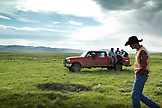 USA, Wyoming, Encampment, ranch hands move towards a corral to begin branding calves, Big Creek Ranch